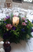 Circlet of flowers, hurricane vase to centre with pillar Candle - Hengrave Hall, Bury Saint Edmunds