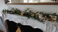 Artificial blossom branches with fresh foliage on mantle piece – Parklands Quendon Hall, Quendon